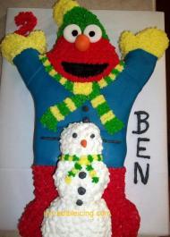 Elmo builds a snowman