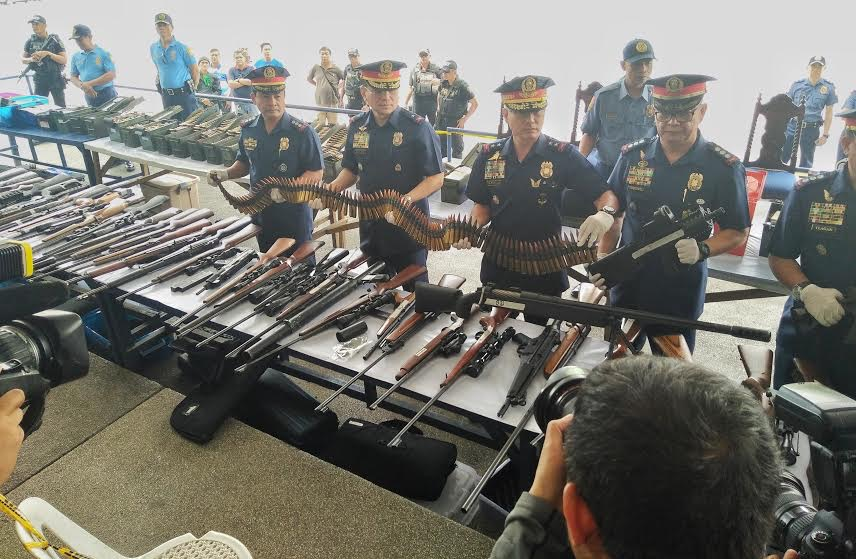 Guns-ammo-explosives-seized-from-INC-building-used-by-expelled-INC-members-Jhesset-Enano-Inq-Mar.-9-2017