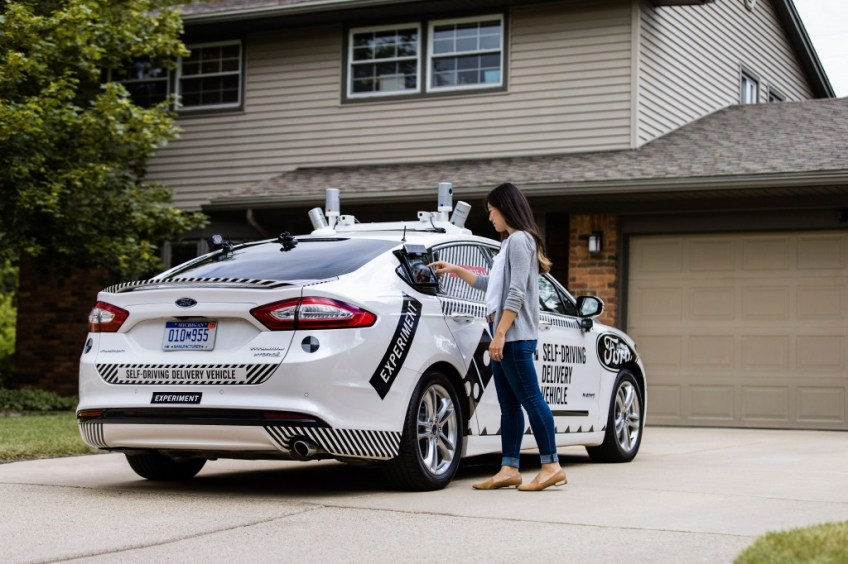 Self-driving car delivers pizza with a human driver!!??