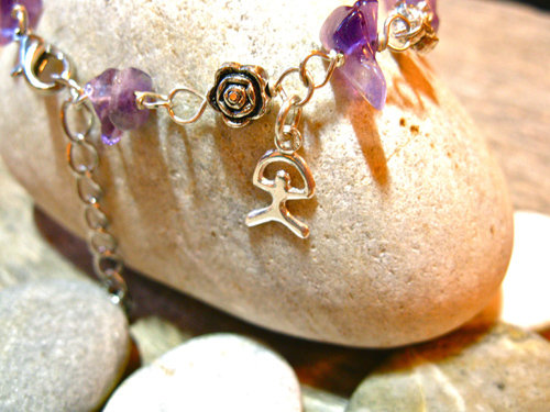Amethyst charm bracelet with Indalo