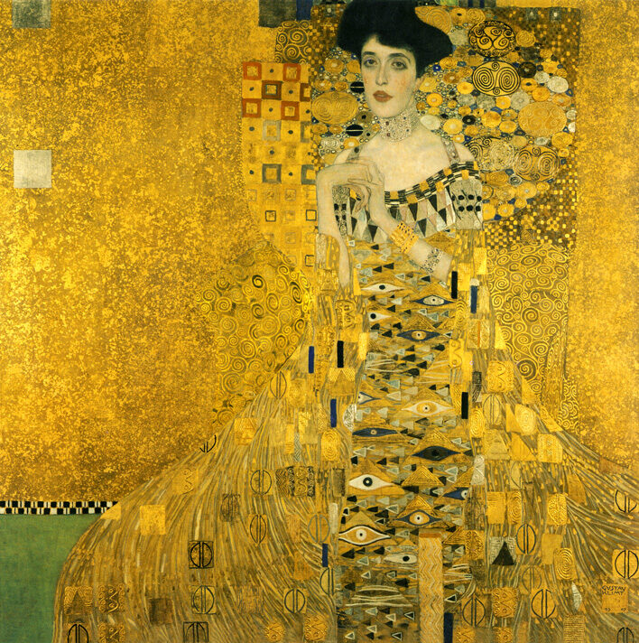 """Known as the """"Woman in Gold"""" in the 2015 British film, see Woman in Gold (film), and as """"Lady in Gold"""" in the Blues Pills album, see Lady in Gold (album). Portrait of Adele Bloch-Bauer I (also called The Lady in Gold or The Woman in Gold) is a painting by Gustav Klimt, completed between 1903 and 1907. The portrait was commissioned by the sitter's husband, Ferdinand Bloch-Bauer [de], a Jewish banker and sugar producer. The painting was stolen by the Nazis in 1941 and displayed at the Österreichische Galerie Belvedere. The portrait is the final and most fully representative work of Klimt's golden phase. It was the first of two depictions of Adele by Klimt—the second was completed in 1912; these were two of several works by the artist that the family owned."""