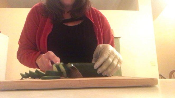 Carrie chopping cucumber using Luke Arm
