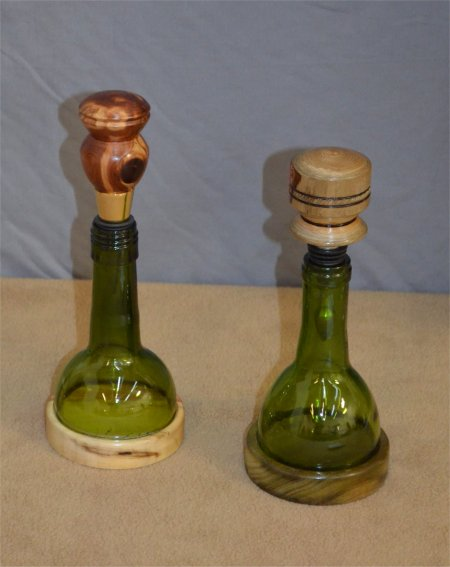 Bottle stoppers with wine bottle tops and turned bases by John Thornton
