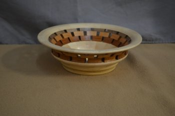 Segmented bowl with open segmented feature ring by Mikeal Jones