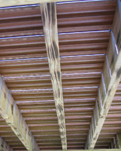underside of wood balcony