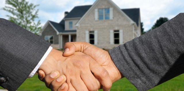 Real estate investment homeownership handshake