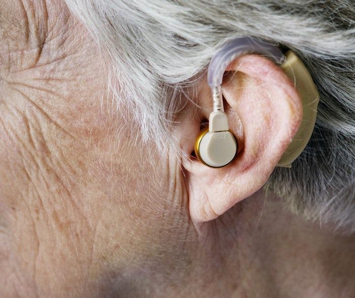 Woman ear hearing aid disability