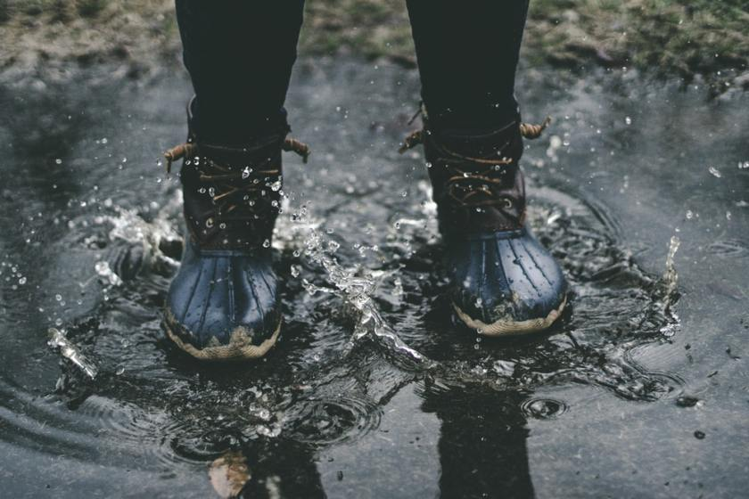 Rain boots water stream spring