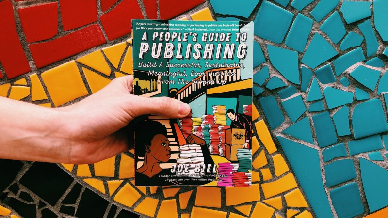 This is an original photograph by Independent Book Review of the paperback book of A People's Guide to Publishing on a multi-colored background