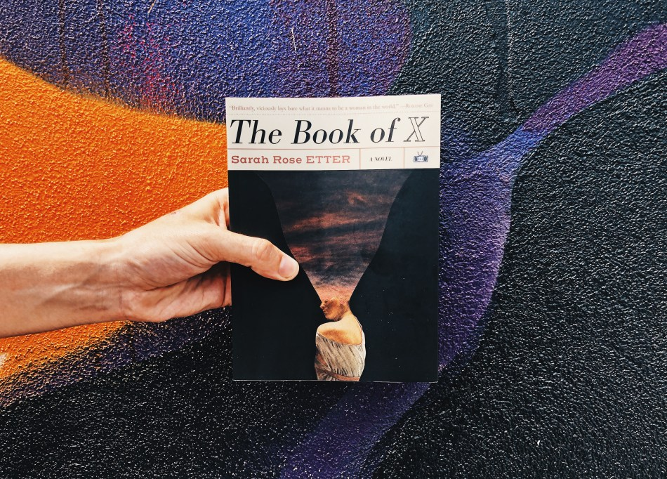 This is an original photograph for an independent book review of the paperback of THE BOOK OF X by Sarah Rose Etter