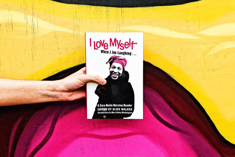 This is a paperback original photo of I Love Myself When I Am Laughing...And Then Again When I am looking mean and impressive, a Zora Neale hurston Reader. Taken by Independent Book Review