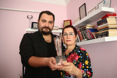 "Cevahir Çokbilir, director of award-winning ""Snowfall Time"", receives in Turkey his ISA official trophy. Here with lead actress and also his mother Naciye Çokbilir."