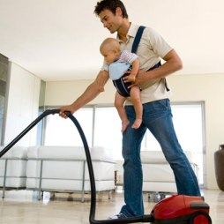 father-with-baby-sling-vacuuming-photo-420x420-ts-78634871