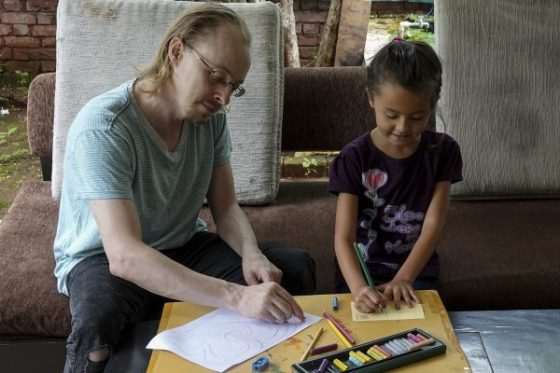 Father and daughter paint together at Khula Aasmaan children's art exhibition