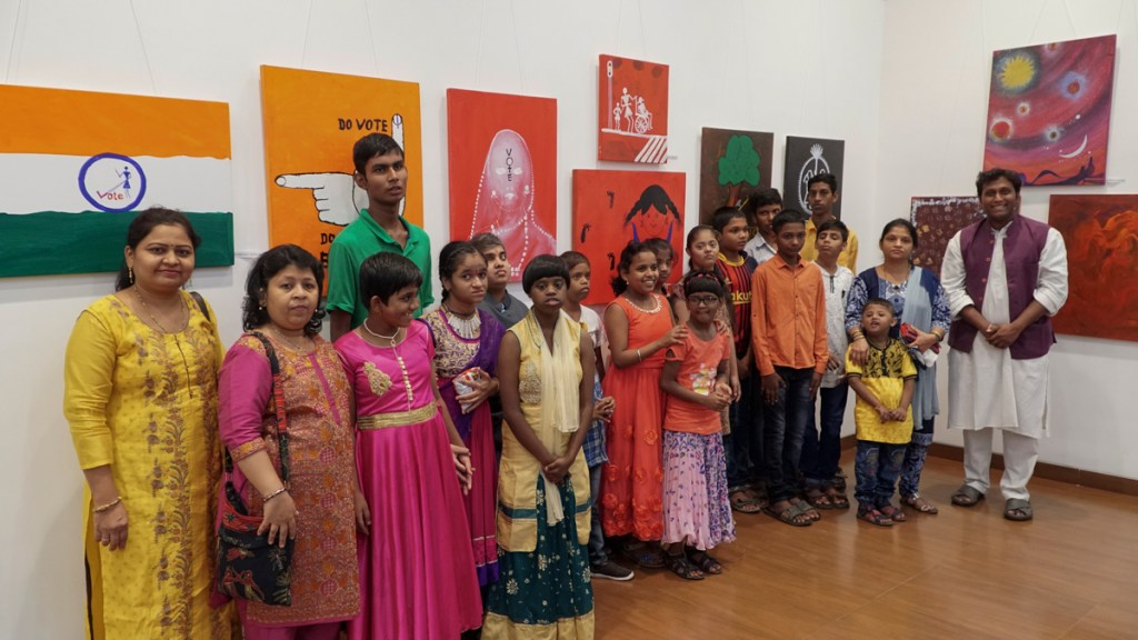 Children with mental disabilities and their teachers at the art exhibition to mark Children's Day