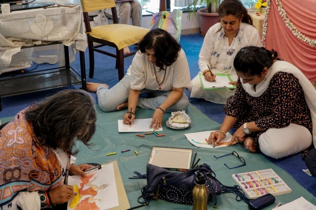 Ladies painting at Khula Aasmaan art workshop