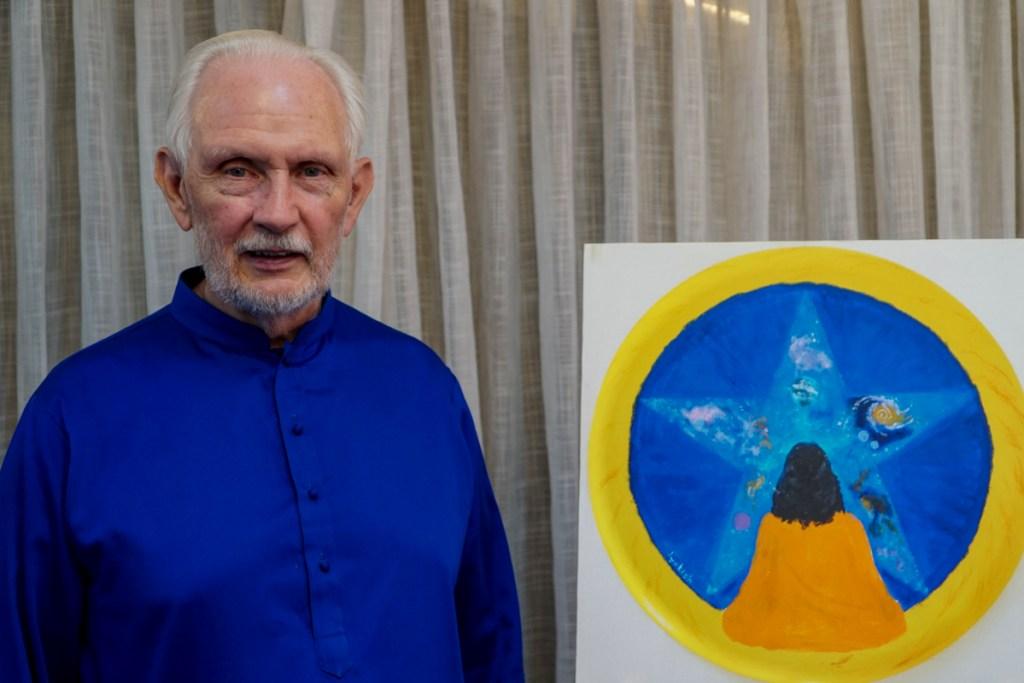 Nayaswami Jyotish with his painting - King of the Infinite, at Ananda Sangha, Pune