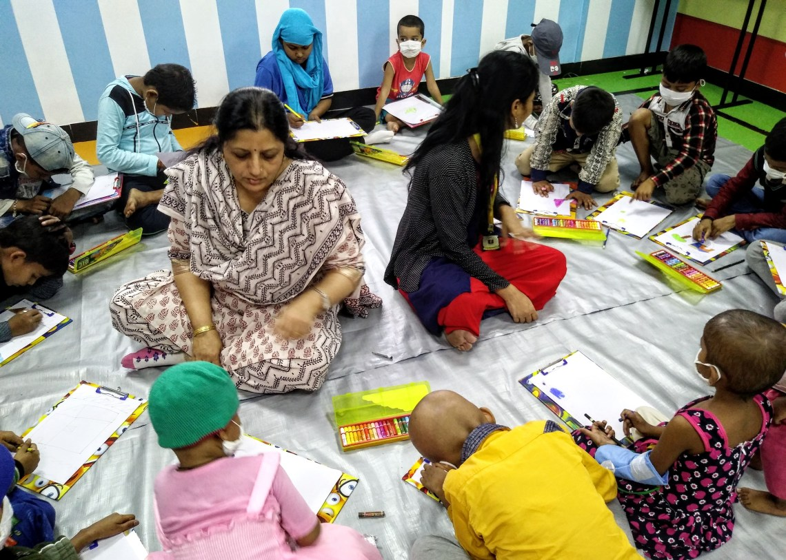 Chitra Vaidya and Archana work with the children during the art workshop at Tata Memorial Centre, Mumbai on World Cancer Day