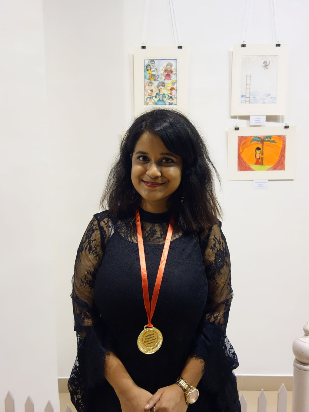 Diptashree Mondal with her medal at Khula Aasmaan art exhibition of medal winning artworks at Mumbai - October 2017. Diptashree's video is part of videos of medal winning college students.