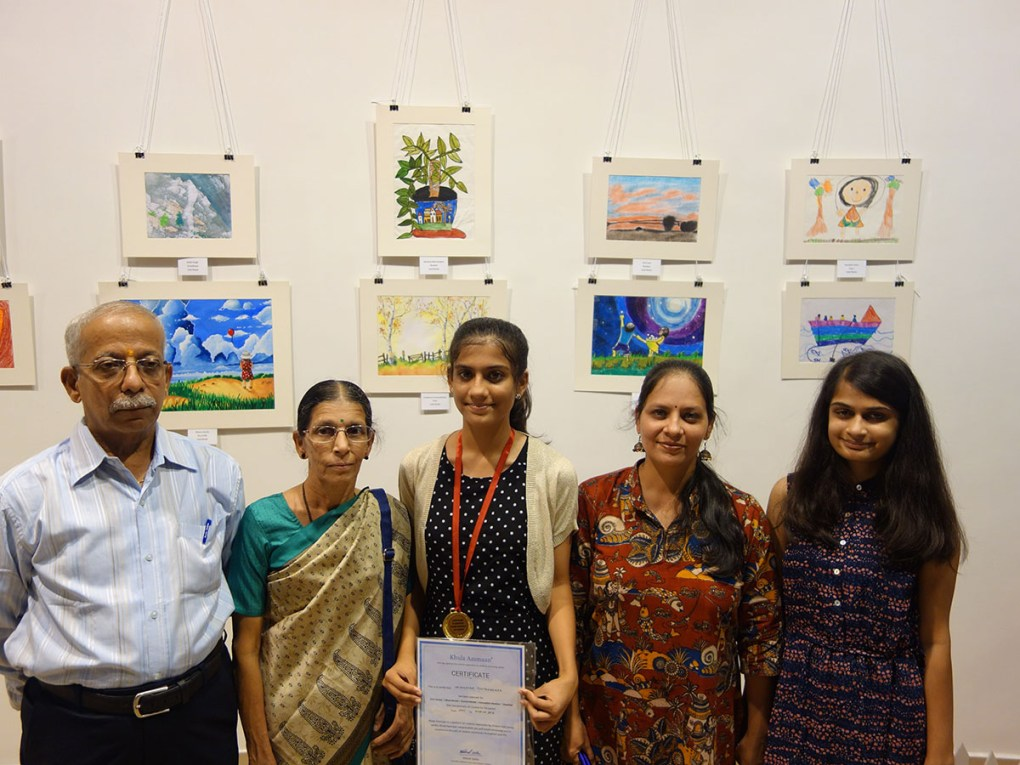 Vaishnavee Puntambekar with her family at Khula Aasmaan art exhibition at Mumbai - October 2017. Vaishnavee's video is part of the videos of medal winning children.