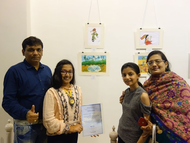 Vidisha Ajmera with her medal and certificate along with family at Khula Aasmaan exhibition of medal winning artworks at Mumbai - October 2017. Vidisha's video is part of videos of medal winning children.