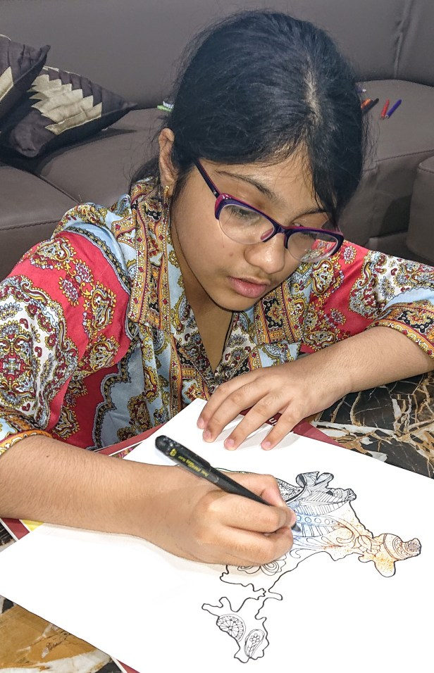 Ayushi Vasnani (class 6), Vadodara working on her painting