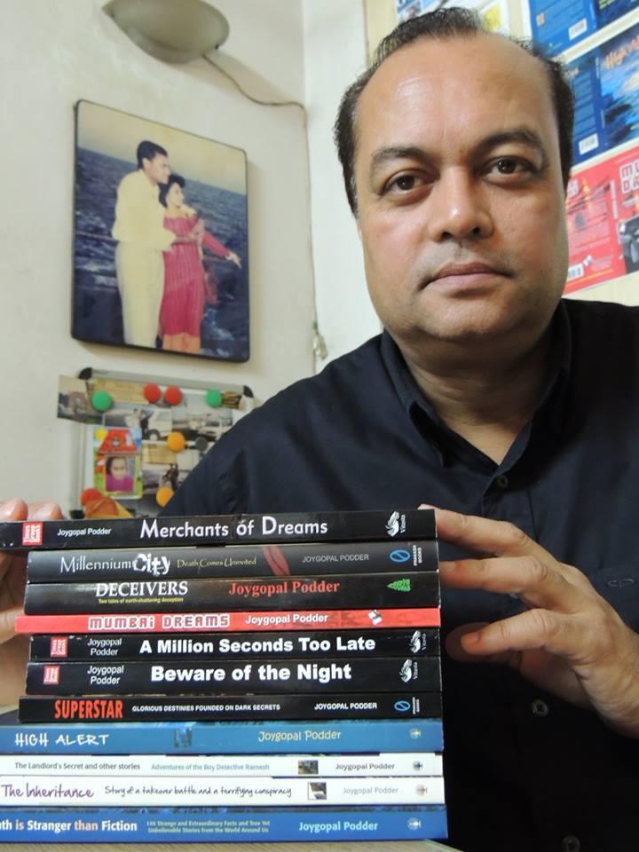 Photo of Joygopal Podder with 11 published books
