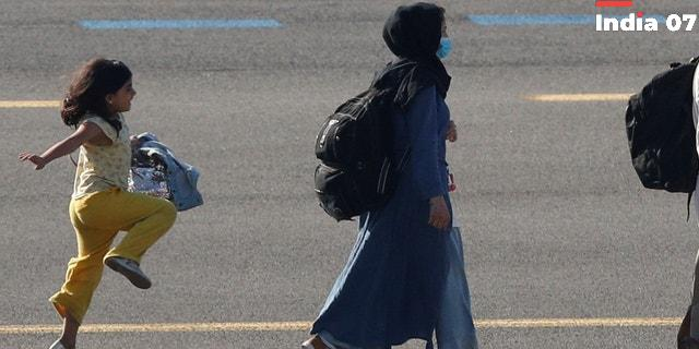 Afghan girl seen in viral photo skipping on airport tarmac after arriving in Brussels following evacuation