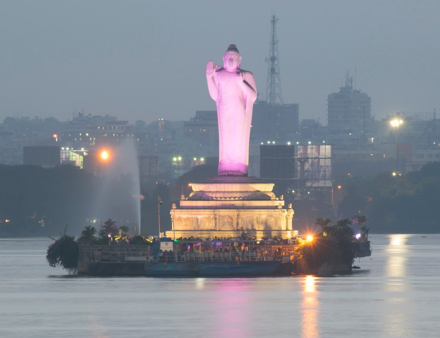 A night time image of the impressive Buddha Statue at Lumbini Park in Hyderabad, Andhra Pradesh
