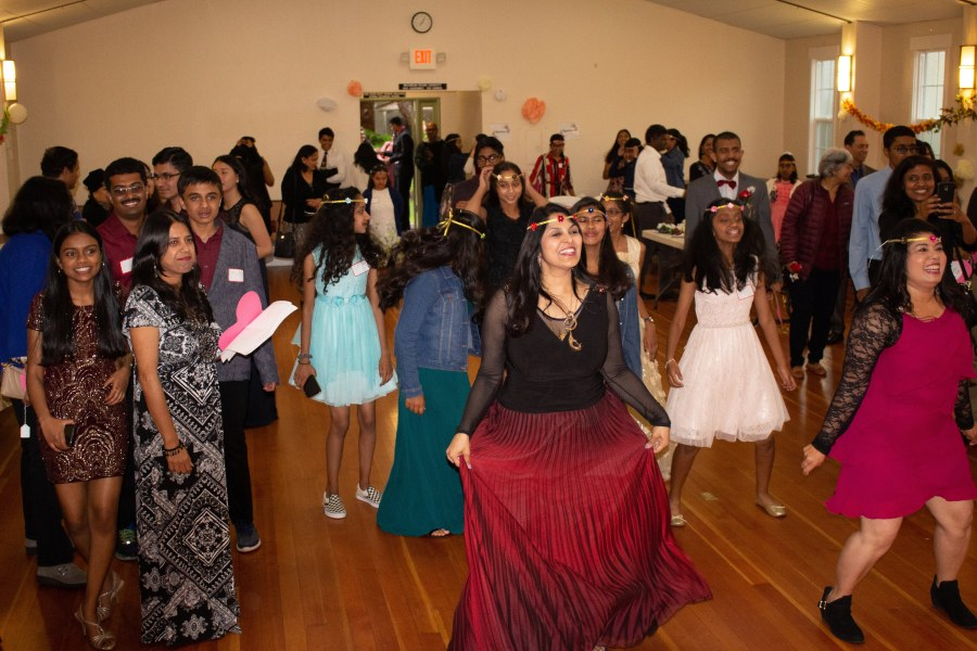 The attendees of the all-inclusive prom having a dance party