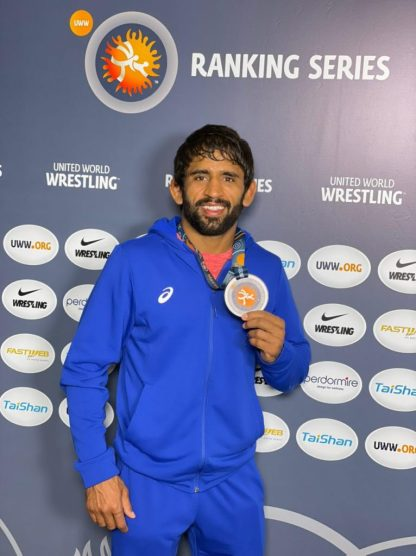 Bajrang Punia shows off his Gold medal in Rome.