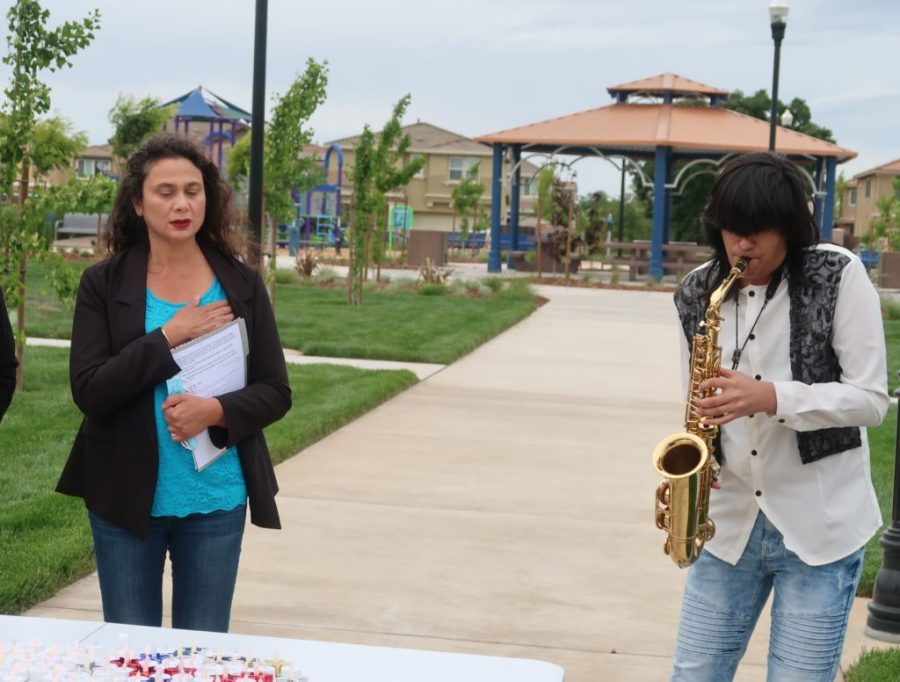 Neil Nayyar performing the Star Spangled Banner at the Singh and Kaur Park.