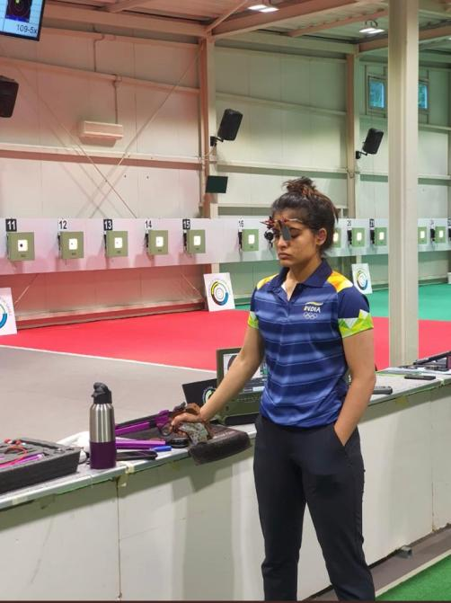 Manu Bhaker preparing to practice in her event - shooting.
