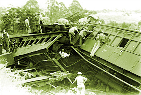 Relief workers inspect smashed carriages after railway accident at Camp Mountain, Queensland