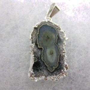 Genuine Fossil Amethyst Silver Plated Pendant