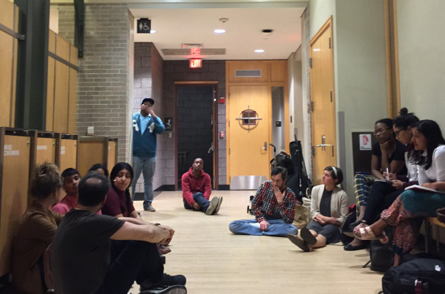 (Photo courtesy: Shawn Young / Herald) About 15 student protesters gathered outside of Carrie Grossman's '00 performance of Hindu chants, questioning her on whether her performance constituted cultural appropriation.