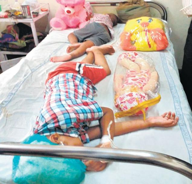 Two girls locked up at a house in Outer Delhi's Samaypur Badli were found by police and neighbours lying on a mattress infested with maggots. (Photo courtesy: The Hindu)