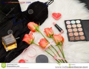 Black Body Orange Roses Lipstick Perfume Eye Shadow Fashionable Concept 91846241