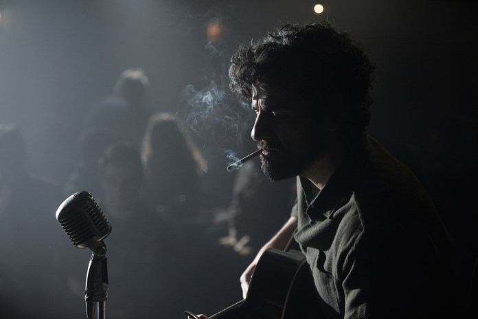 Oscar Isaac performing in Joel and Ethan Coens INSIDE LLEWYN DAVIS