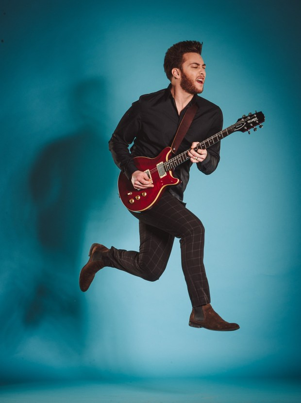 WILL JACOBS RED GUITAR JUMPING PHOTO BY PERRON #7 MANAGEMENT
