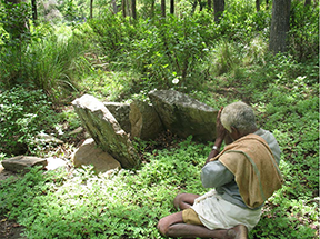 An image of a Soliga man worshipping at a sacred site