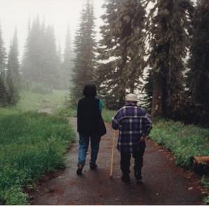 Grandfather Misha Duvan and Grandmother Nadia Duvan walking up Mt. Rainier