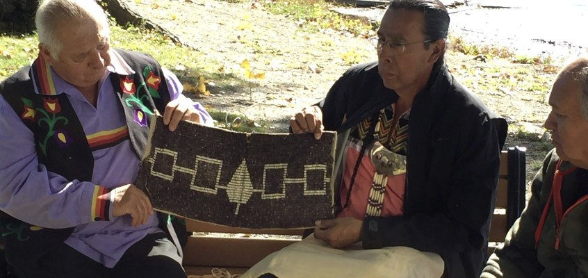 Returning the Hiawatha Belt to Onondaga Lake. Pictured are the Tom Porter, Tadodaho Sid Hill and Ken Maracle with the original belt that is more than 1000 years old.
