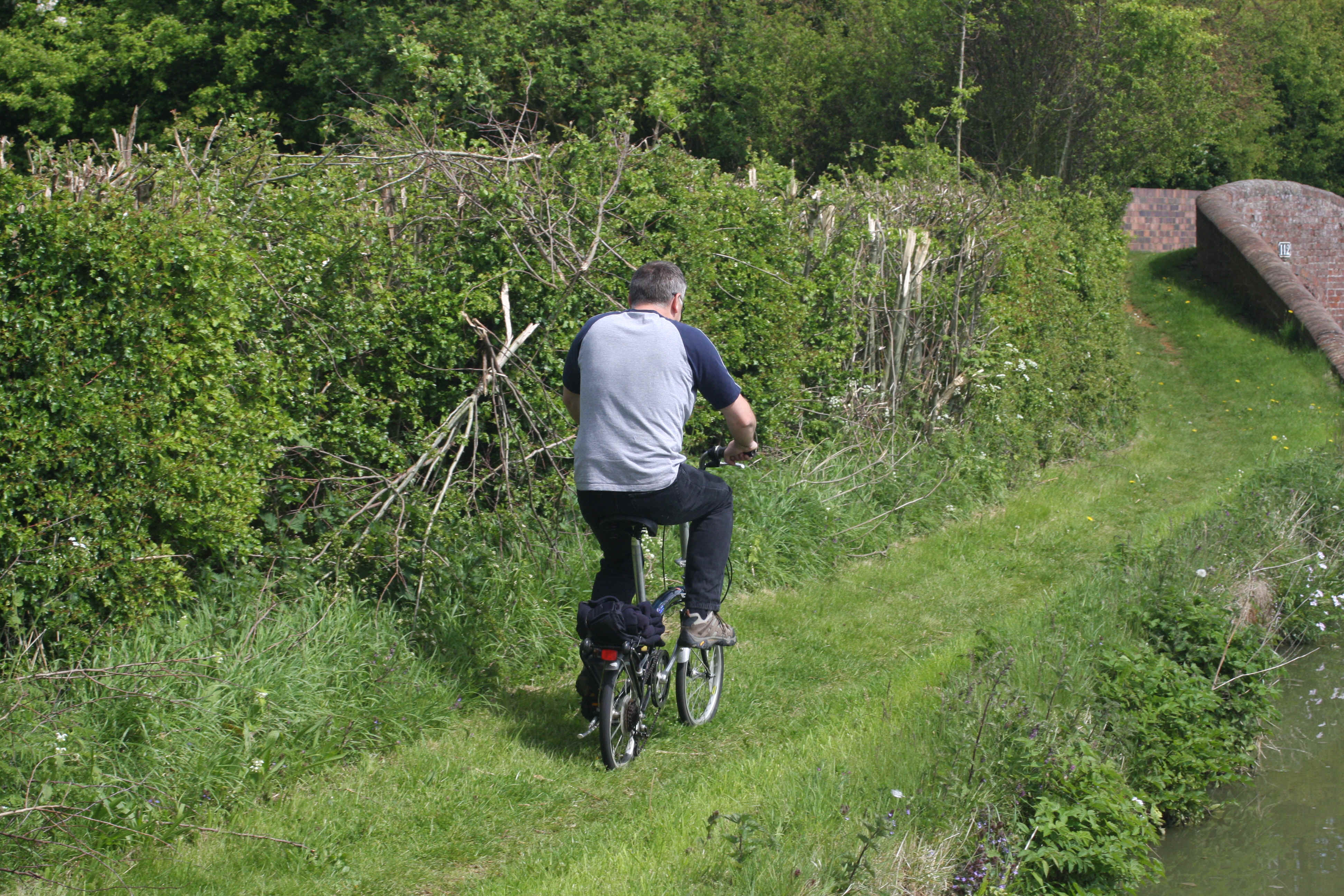 Those little wheels hardly look equal to the rough old towpath - Nick did well!