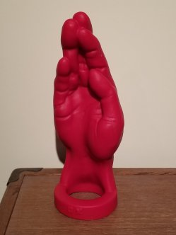 The Jo-Fist is on it's base with the fingers sticking up.