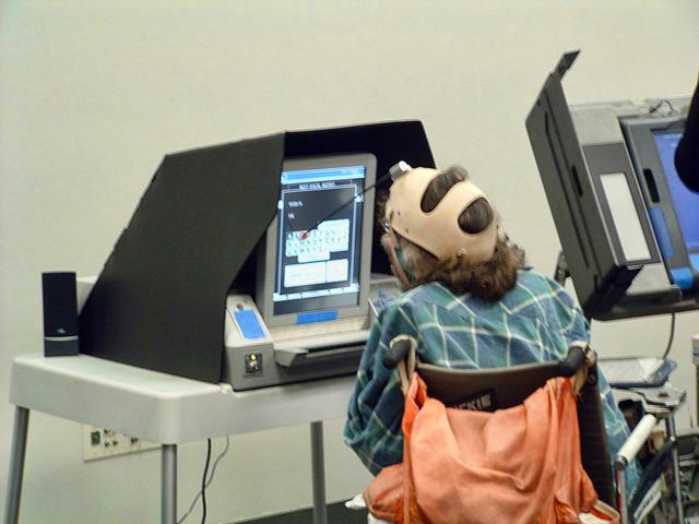 Quadriplegic voter using a BMD, photo by Joebeone