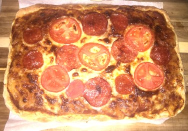 Slightly over-baked finished pizza. Awesomely yummy!