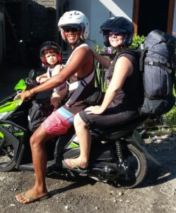 family of three on a bike