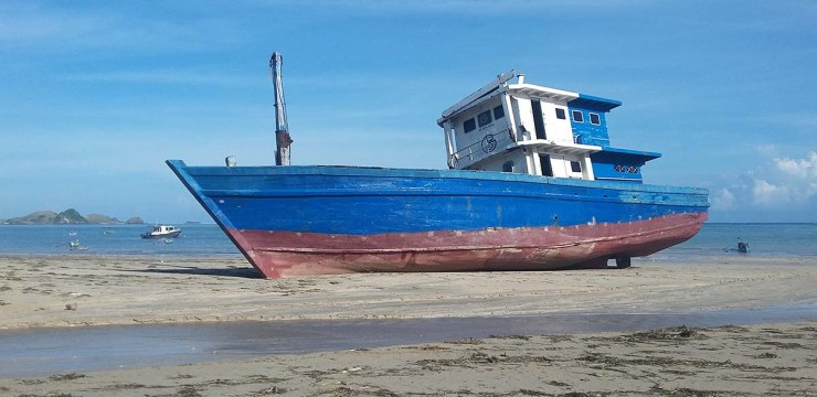 beached wooden boat