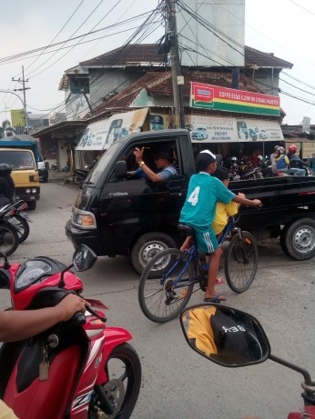 Bicycles across Indonesia can carry multiple children and other unimaginable loads.